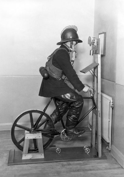 Fireman undergoing an ergometer test whilst wearing full gear, including breathing apparatus at Lambeth headquarters
