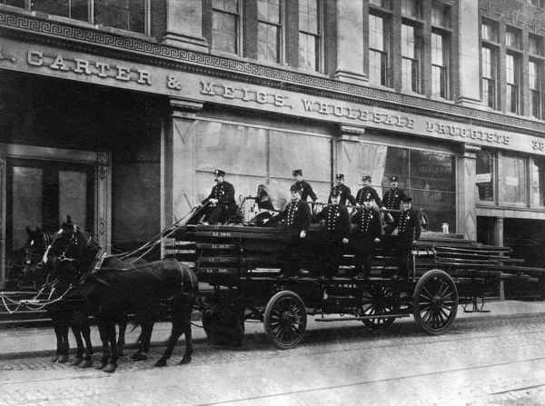 A horse-drawn vehicle of the Goodyear Fire & Rubber Co, Akron, Ohio, USA, with its crew of firefighters