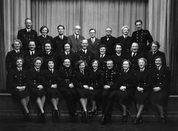 Group photo, men and women at an AFS (Auxiliary Fire Service) concert party, 19 February 1955
