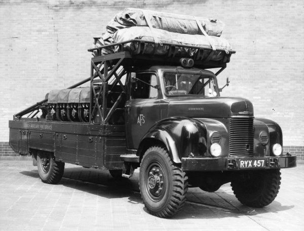 LFB-AFS Commer transportable water unit (TWU, commonly known as the Bikini). It carries three deflated rubber rafts and nine light portable pumps. Fitted to the chassis is a hand-operated crane of half a ton capacity which can be operated by two men