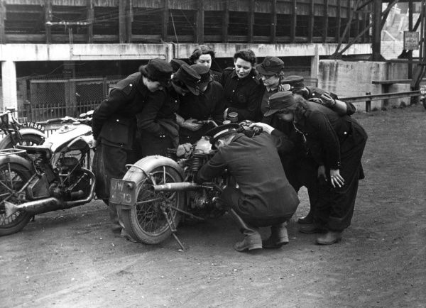 LCC-LFB junior dispatch riders during training at the New Cross speedway track in South London on 22 April 1942 -- a spot of bother with a bike
