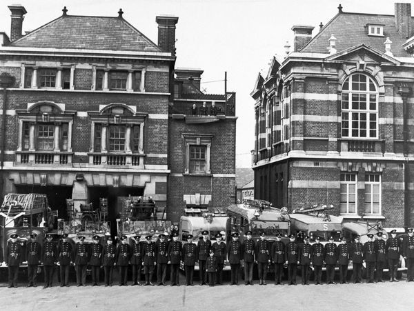 Regular London firefighters side by side with their Auxiliary (AFS) counterparts at Tottenham fire station. The building next door is Tottenham Town Hall