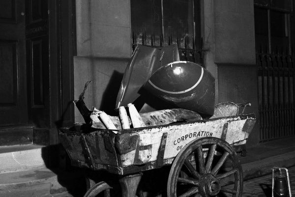 WW2 - City of London Corporation handcart containing scrap metal, including bomb ordinance, Southwark Bridge, London. The cart also contains iron railings and general household metalwork, collected and recycled for the war effort. Date: 1940s