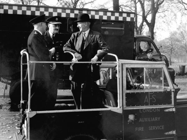 Attending an AFS exercise in Hyde Park, London, on 27 October 1957 -- the Director General of Civil Defence, Sir Sidney Kirkman (1895-1982), the Chief Inspector of Fire Services, Mr H M Smith, and the Chief Officer of the London Fire Brigade, Mr F W Delve