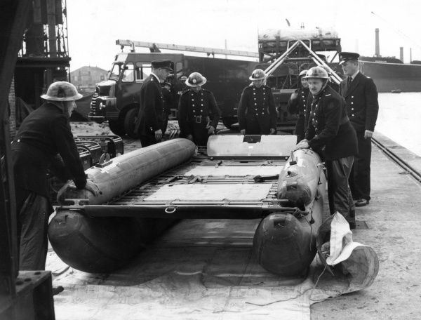 LFB-AFS fully inflated Bikini raft, with AFS personnel. The Commer transportable water unit (TWU) from which it has been unloaded can be seen in the background