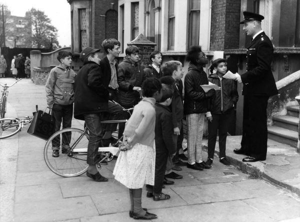 National Fire Prevention Campaign, London -- Station Officer Albert Benjamin of Clapham Fire Station talking to children in Sommerleyton Road, Brixton, South London