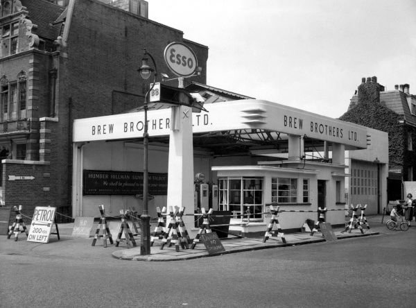 Brew Brothers petrol station in Old Brompton Road, London SW7, where a fire and explosion occurred in a basement store, 20 July 1957. The damage at ground level involved the public paving, pavement lights in the station forecourt, window glass