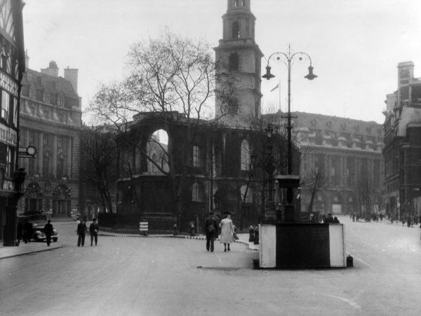 St Clement Danes Church, Strand, London, seen here on 11 May 1941, the day after it was nearly destroyed in a bombing raid. The interior was gutted by fire, but the outer walls, tower and steeple survived. Its architect was Sir Christopher Wren