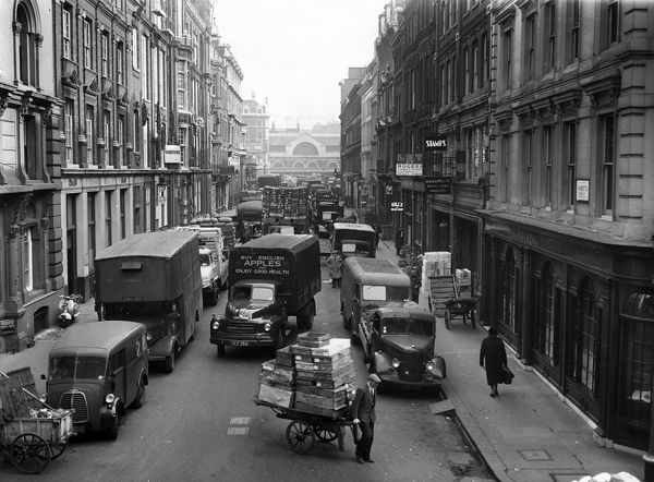 Traffic congestion in the Covent Garden area, London WC2, showing a view along Henrietta Street from the corner of Bedford Street during the morning of 26 March 1959