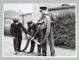 AFS volunteers undergoing hose drill, WW2