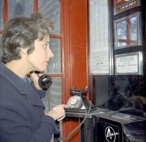 Example of a woman dialling 999