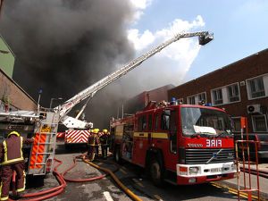 Firefighters in action at a fire, VDC House, Wembley