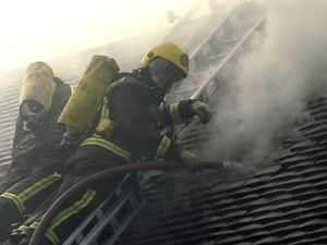 Firefighters respond to a house fire, North London