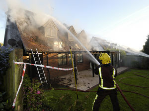 Firefighters working at scene of domestic fire, Harrow