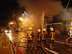 Firefighters working at scene of pub fire, SE London