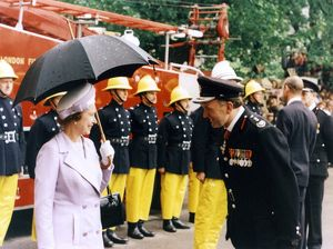 Queen Elizabeth II inspecting firefighters, London