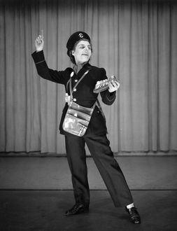 Woman performing as a bus conductor in a comic sketch